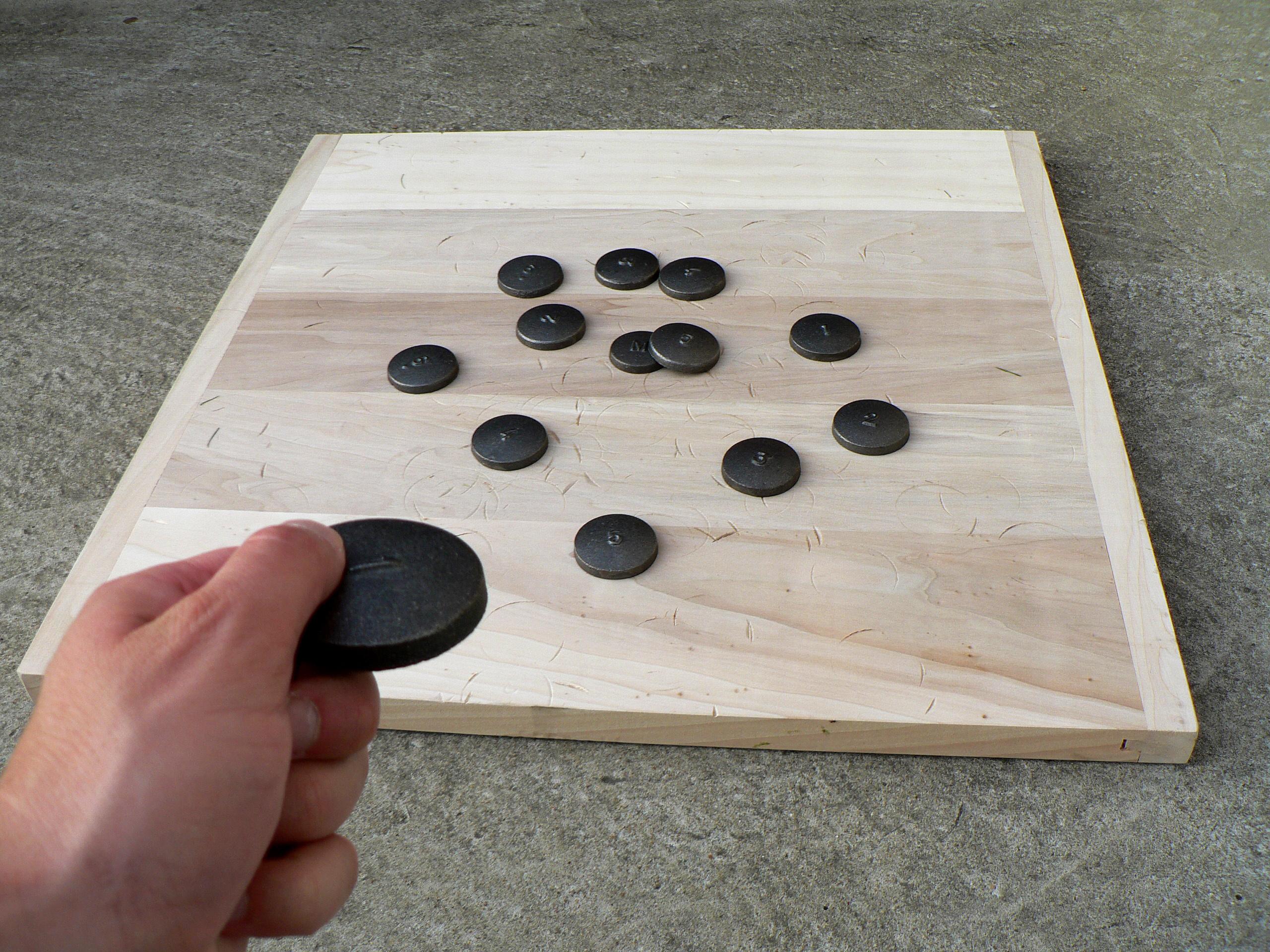 Planche de jeux de palets